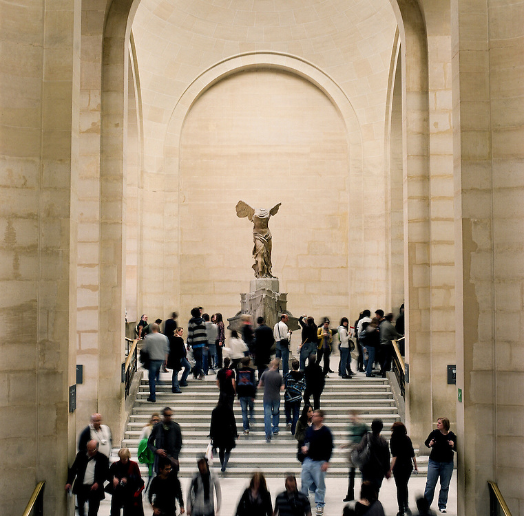 Tourists walk the staircase below the Winged Victory of Samothrace at the Louvre Museum in Paris France.<br /> <br /> NOTE: Larger resolution versions of these images are available on request.