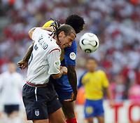 Photo: Chris Ratcliffe.<br /> England v Ecuador. 2nd Round, FIFA World Cup 2006. 25/06/2006.<br /> Rio Ferdinand of England clashes with Edwin Tenorio of Ecuador.