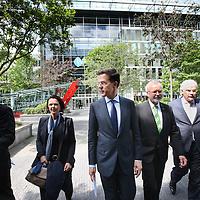 Nederland, Amsterdam , 15 mei 2014. <br /> Minister-president Rutte  (m) opende donderdag 15 mei de Nederlandse vestiging van de Europese Investeringsbank (EIB) in Amsterdam. <br /> Pim van Ballekom, vice-president (rechts)  en tussen hen  Werner Hoyer, de president van de EIB. <br /> Aankomst van de Rutte en Van Ballekom.De EIB is het financieringsinstituut van de Europese Unie.<br /> De 28 lidstaten zijn aandeelhouder. De bank is opgericht in 1958 bij het Verdrag van Rome en heeft als doel projecten te financieren die zijn gericht op de versterking van de Europese economie.<br /> Prime Minister Rutte (m) opened Thursday, May 15th, the Dutch branch of the European Investment Bank (EIB) in Amsterdam. Left Pim van Ballekom, Vice-President of the EIB and in between Werner Hoyer, president.<br /> <br /> The EIB is the financing institution of the European Union.<br /> Arrival of Rutte and Van Ballekom.