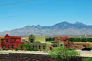 Housing in an artist community with a backdrop of the Santa Rita Mountains, Santa Cruz County, Tubac, Arizona, USA.