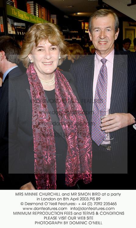 MRS MINNIE CHURCHILL and MR SIMON BIRD at a party in London on 8th April 2003.PIS 89