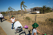 Families walk past an old home boat during Santa Clara County Park's Day on the Bay event at Don Edwards San Francisco Bay National Wildlife Refuge in Alviso, California, on October 9, 2016. (Stan Olszewski/SOSKIphoto)