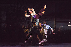 © Licensed to London News Pictures. 05/10/2015. London, UK. Jennifer White at the top. BalletBoyz return to Sadler's Wells with their programme Young Men, a portrayal of love, loss and survival set against the backdrop of war. Produced by BalletBoyz artistic directors Michael Nunn and William Trevitt, Young Men is choregraphed by Ivan Perez and features an original score by Keaton Henson. Photo credit: Bettina Strenske/LNP
