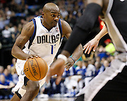 Dallas Mavericks point guard Mike James (13) drives to the basket against the San Antonio Spurs at American Airlines Center in Dallas, Texas, on January 25, 2013.  (Stan Olszewski/The Dallas Morning News)