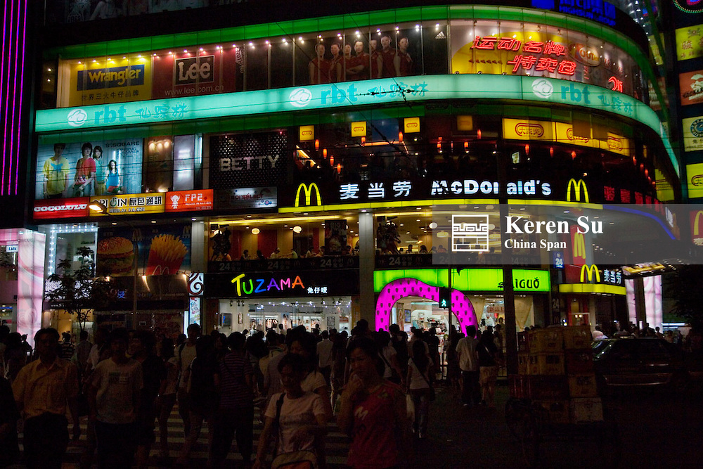 Night view of neon lights in busy shopping center, Guangzhou, Guangdong Province, China