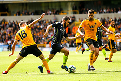 Bernardo Silva of Manchester City takes on Diogo Jota and Ruben Neves of Wolverhampton Wanderers - Mandatory by-line: Robbie Stephenson/JMP - 25/08/2018 - FOOTBALL - Molineux - Wolverhampton, England - Wolverhampton Wanderers v Manchester City - Premier League
