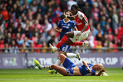 Asisat Oshoala of Arsenal Ladies jumps over Katie Chapman of Chelsea Ladies sliding tackle - Mandatory byline: Jason Brown/JMP - 14/05/2016 - FOOTBALL - Wembley Stadium - London, England - Arsenal Ladies v Chelsea Ladies - SSE Women's FA Cup