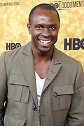 "October 6 New York, NY- Actor Gbenga Akinnagbe at the HBO Premiere of "" Sing Your Song"" chronicling the life & iconic career of legendary entertainer & civil rights hero Harry Belafonte held at the Apollo Theater on October 6, 2011 in Harlem, New York City. Photo Credit: Terrence Jennings"