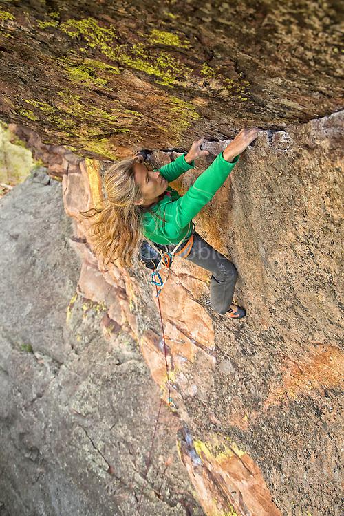"""Legendary climber Lynn Hill climbing """"Just Another Boy's Climb"""" 12a, The Slab, Boulder, Colorado."""