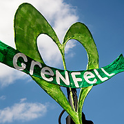 Notting Hill Carnival August  2017. A green loveheart flies from a carnival float with the word 'Grenfell' on it