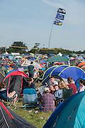 An EU flag marks one of the tents in the already busy; main campsite - The 2016 Latitude Festival, Henham Park, Suffolk.