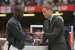 CARDIFF, WALES - SATURDAY, MAY 13th, 2006: Prince William hands out runners'-up medals to West Ham United's Marlon Harewood after the Hammers lost on penalties to Liverpool in the FA Cup Final at the Millennium Stadium. (Pic by David Davies/Pool/Propaganda)