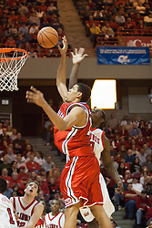 11 February 2006:  .Greg Dilligard (back) swats the attempt by Patrick O'Bryant to the stands..Illinois State Redbirds fall to the Bradley Braves at home in Redbird Arena in Normal Illinois.