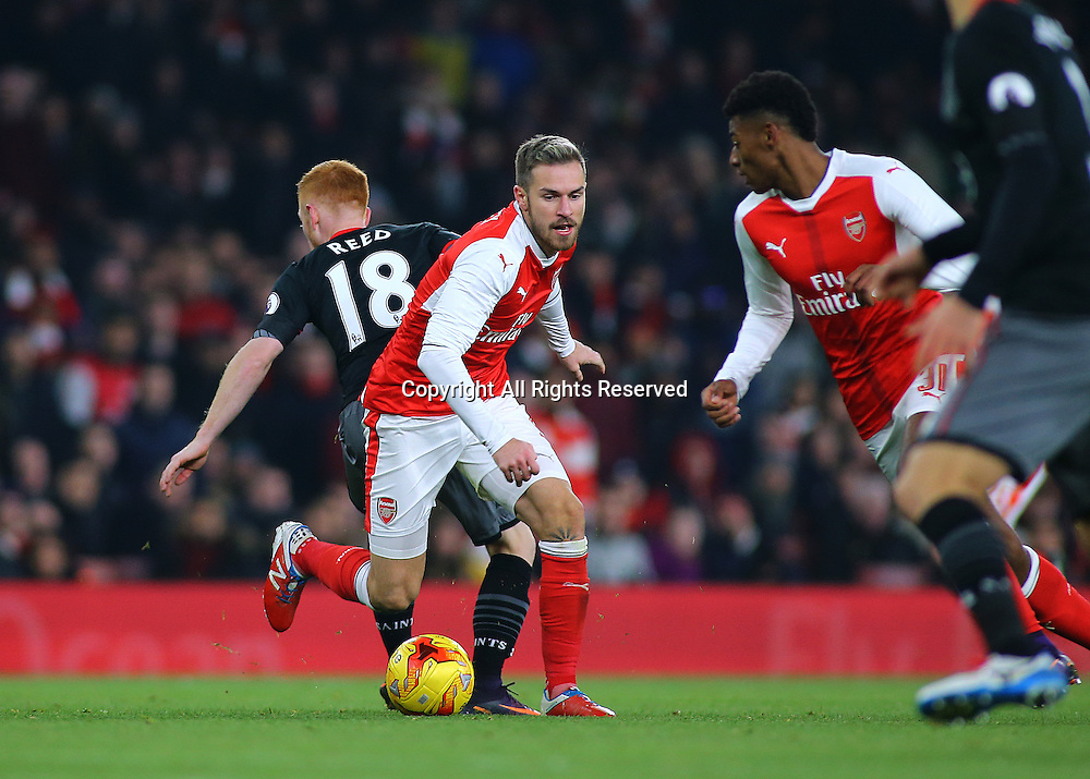 30.11.2016. Emirates Stadium, London, England. EFL Cup Football, Quarter Final. Arsenal versus Southampton. Arsenal Midfielder Aaron Ramsey sends Southampton Midfielder Harrison Reed the wrong way, during an Arsenal attack