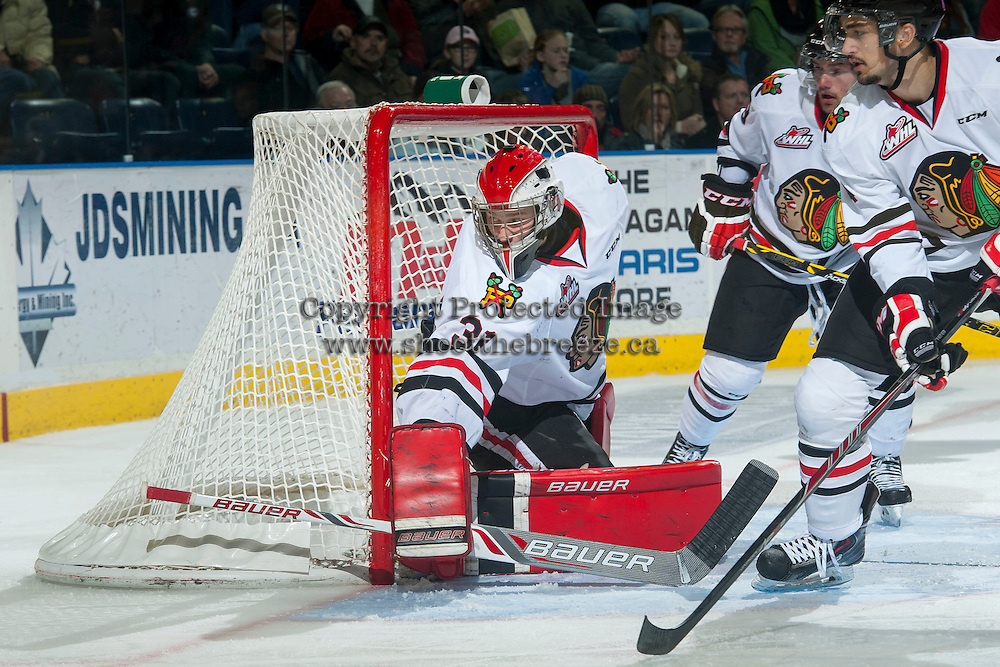 KELOWNA, CANADA - NOVEMBER 22: Adin Hill #31 of Portland Winterhawks defends the net against the Kelowna Rockets on November 22, 2014 at Prospera Place in Kelowna, British Columbia, Canada.  (Photo by Marissa Baecker/Shoot the Breeze)  *** Local Caption *** Adin Hill';