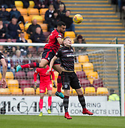 28th April 2018, Fir Park, Motherwell, Scotland; Scottish Premier League football, Motherwell versus Dundee; Steven Caulker of Dundee clears from James Scott of Motherwell