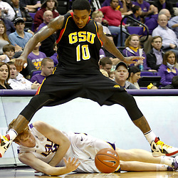 December 29, 2011; Baton Rouge, LA; LSU Tigers forward Eddie Ludwig (13) and Grambling State Tigers guard Quincy Roberts (10) chase after a loose ball during the first half of a game at the Pete Maravich Assembly Center.  Mandatory Credit: Derick E. Hingle-US PRESSWIRE
