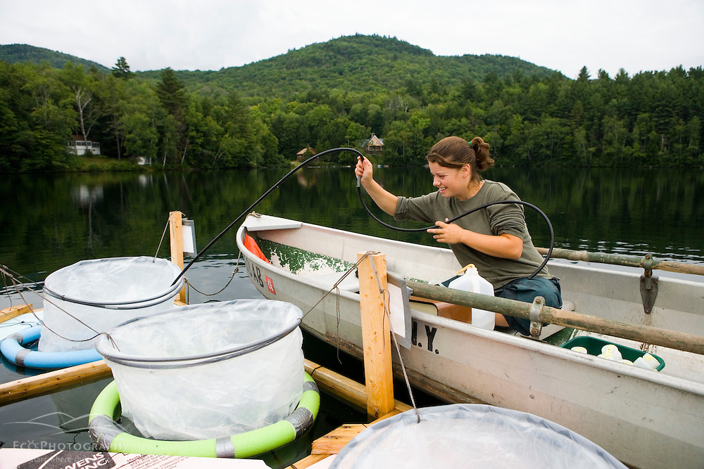 A researcher takes water samples as part of an experiment on Mirror Lake in the Hubbard Brook Experimental Forest in Woodstock, NH.  White Mountain National Forest.