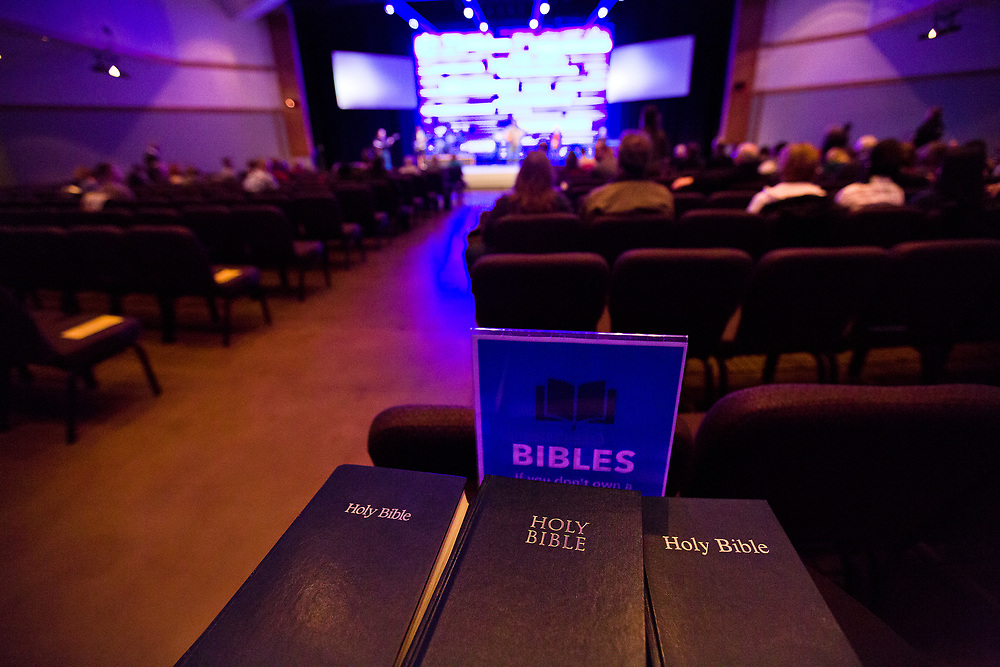 Bibles are stacked at the back entrance of the Live Auditorium during service at Door Creek Church in Cottage Grove, Wisconsin, Sunday, Feb. 4, 2018.