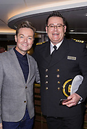 Stephen Mulhern and Britannia's captain Wesley Dunlop at the premiere of Astonishing in Southampton. The show is a revolutionary magic and illusion show produced by singer Jonathan Wilkes and BAFTA-winning presenter and entertainer Mulhern. Astonishing is currently live on three P&O Cruises ships Britannia, Azura and Ventura. It combines the production talents of Mulhern and Wilkes with the spectacular dance moves of leading choreographer Paul Domaine and the mind-blowing trickery of master illusionist Guy Barrett. <br /> Picture date: Sunday June 17, 2018.<br /> Photograph by Christopher Ison ©<br /> 07544044177<br /> chris@christopherison.com<br /> www.christopherison.com