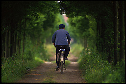An eldrely man rides a bicycle in the countryside outside of Shanghai. China. (Photo © Jock Fistick)