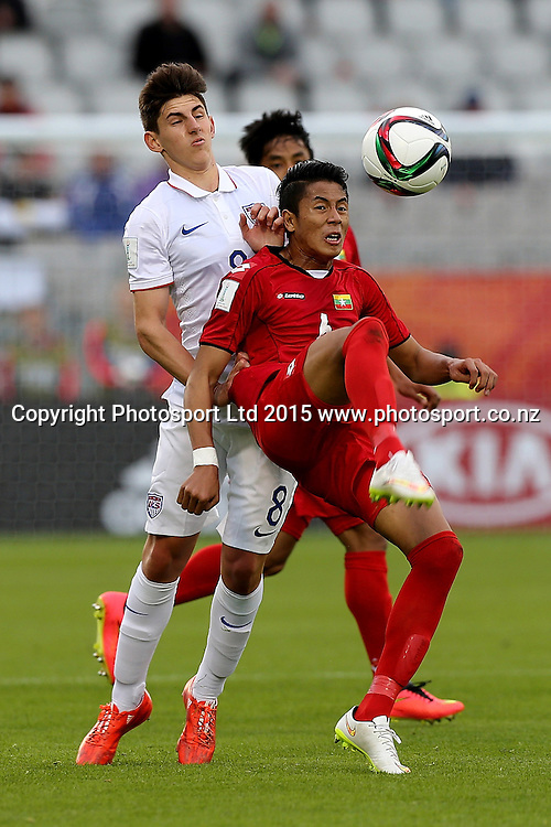 Emerson Hyndman of USA, left, is beaten to the ball by Kyaw Min Oo of Myanmar in the Group A FIFA U20 World Cup Match between USA and Myanmar at Northlands Event Centre, Whangarei, Northland, New Zealand, Saturday, May 30, 2015. Copyright photo: David Rowland / www.photosport.co.nz
