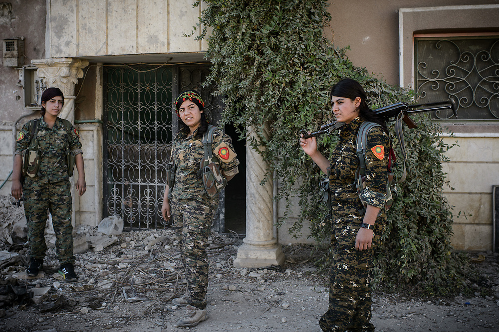 Members of the Sinjar Women's Units (YJŞ) patroling in the eastern part of Raqqa, Syria, October 16, 2017