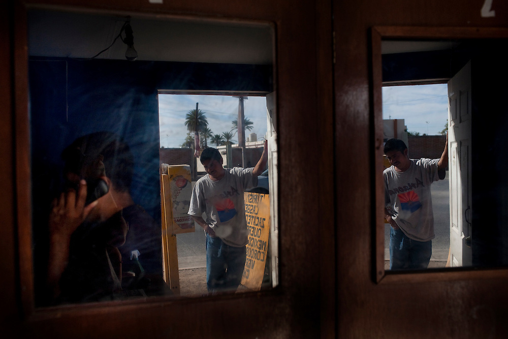 Migrants use phone booths in Altar, Sonora to call their families and guides in order to coordinate their border crossing.  Altar is the starting point for many migrants' journeys to the US. In Altar they find guides and coyotes to take them across the border.  The town's economy is nearly entirely dependent on the migrants. Recently drug cartels have become involced in the smuggling of people, using the same routes as the drugs and charging the migrants an exit tax to leave the country.