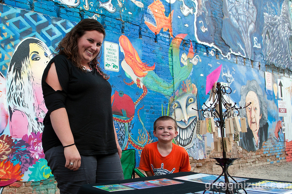 Mural artist Sara Aycock and her son during Freak Alley Gallery's sixth annual mural event in downtown Boise, Idaho on August 13, 2016.<br /> <br /> The week long event provided an &quot;art-in-motion&quot; experience as it welcomed the public to watch artists work on their murals.