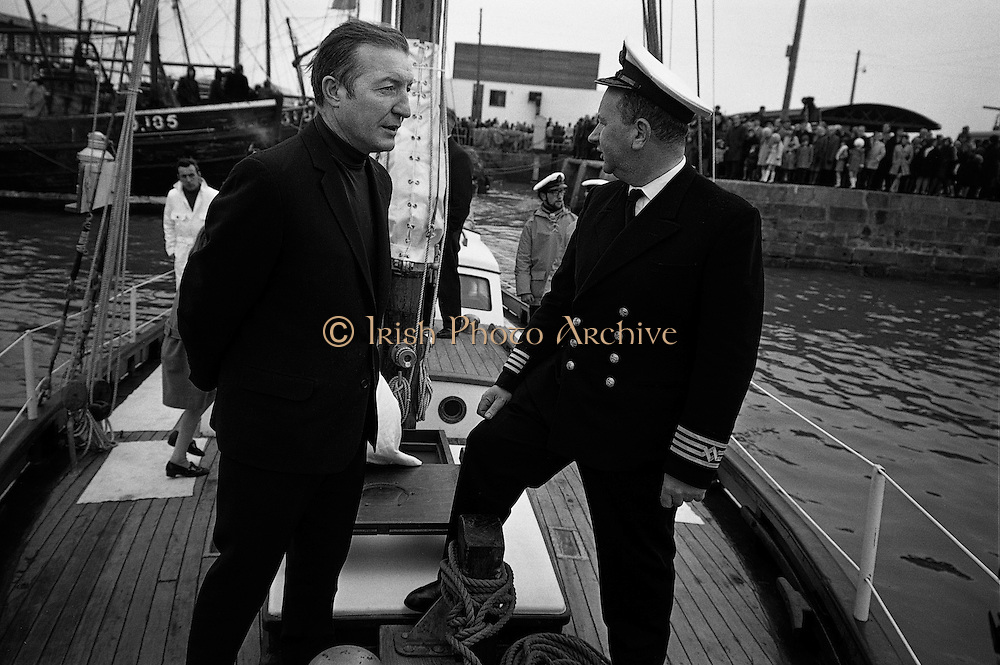 Charles Haughey, himself a keen sailor, talks to young crew members at the commissioning of the Asgard as Ireland's first sail training vessel. The yacht originally belonged to Erskine Childers Snr. and was used in the 1914 Howth gun-running.25.03.1969