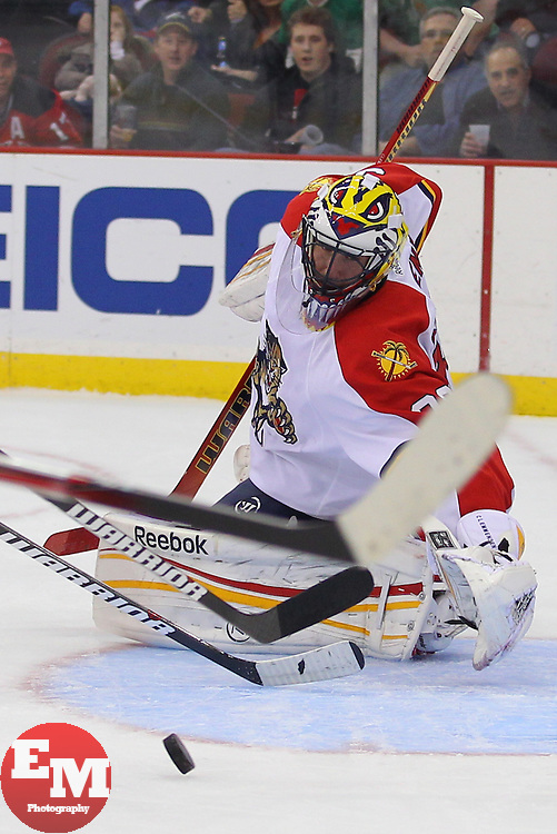 Mar 23, 2013; Newark, NJ, USA; Florida Panthers goalie Scott Clemmensen (30) looks for the loose puck during the first period of their game against the New Jersey Devils at the Prudential Center.