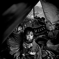 Victims of earthquake - Child and mother