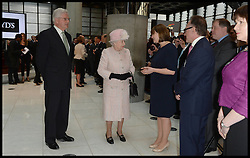 HM The Queen is escorted around the Lloyds of London building in the City of London, United Kingdom., by The Chairman of Lloyds of London John Nelson,  Thursday, 27th March 2014. Picture by Andrew Parsons / i-Images