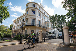 © Licensed to London News Pictures. 31/07/2018. London, UK. Marina Wheeler QC, wife of former Foreign Secretary Boris Johnson, leaves the official residence of the Foreign Secretary at Carlton Gardens in central London by bicycle. A removals team has been seen packing possessions as Boris Johnson prepares to move out of the property after resigning as Foreign Secretary. Photo credit: Rob Pinney/LNP