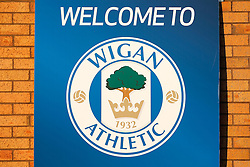 The Wigan Athletic club crest outside the DW stadium - Photo mandatory by-line: Rogan Thomson/JMP - 07966 386802 - 22/09/2014 - SPORT - FOOTBALL - Wigan, England - DW Stadium - Wigan Athletic v Ipswich Town - Sky Bet Championship.
