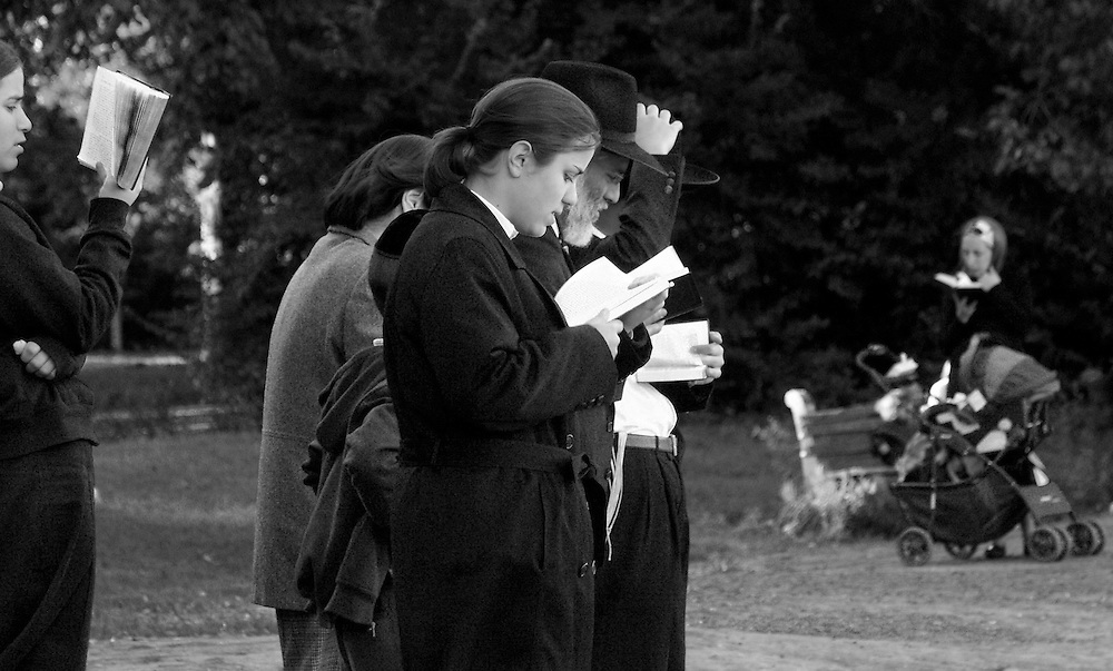 Prayers being said on the Sabbath at Prospect Park, facing the lake.