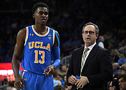 Feb 28, 2019; Los Angeles, CA, USA; UCLA Bruins head coach Murry Bartow (right) talks with guard Kris Wilkes (13) in the second half against the Southern California Trojans at Pauley Pavilion. UCLA defeated USC 93-88 in overtime.
