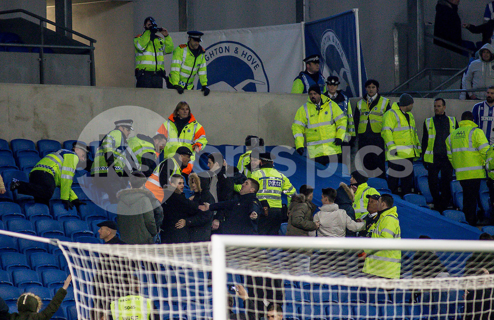 Millwall fans being tackled by the police during the Sky Bet Championship match between Brighton and Hove Albion and Millwall at the AMEX Stadium, Brighton, England on 12 December 2014. Photo by Liam McAvoy.