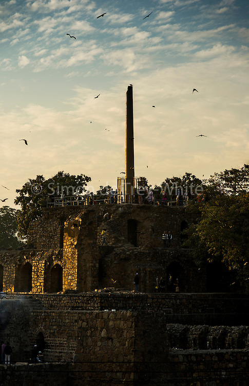 4th February 2016, New Delhi, India. View of the ruins of Feroz Shah Kotla in New Delhi, India on the 4th February 2016<br /> <br /> PHOTOGRAPH BY AND COPYRIGHT OF SIMON DE TREY-WHITE a photographer in delhi<br /> + 91 98103 99809. Email: simon@simondetreywhite.com<br /> <br /> People have been coming to Firoz Shah Kotla to pray to and leave written notes and offerings for Djinns in the hopes of getting wishes granted since the late 1970's. Jinn, jann or djinn are supernatural creatures in Islamic mythology as well as pre-Islamic Arabian mythology. They are mentioned frequently in the Quran  and other Islamic texts and inhabit an unseen world called Djinnestan. In Islamic theology jinn are said to be creatures with free will, made from smokeless fire by Allah as humans were made of clay, among other things. According to the Quran, jinn have free will, and Iblīs abused this freedom in front of Allah by refusing to bow to Adam when Allah ordered angels and jinn to do so. For disobeying Allah, Iblīs was expelled from Paradise and called &quot;Shayṭān&quot; (Satan).They are usually invisible to humans, but humans do appear clearly to jinn, as they can possess them. Like humans, jinn will also be judged on the Day of Judgment and will be sent to Paradise or Hell according to their deeds. Feroz Shah Tughlaq (r. 1351&ndash;88), the Sultan of Delhi, established the fortified city of Ferozabad in 1354, as the new capital of the Delhi Sultanate, and included in it the site of the present Feroz Shah Kotla. Kotla literally means fortress or citadel.