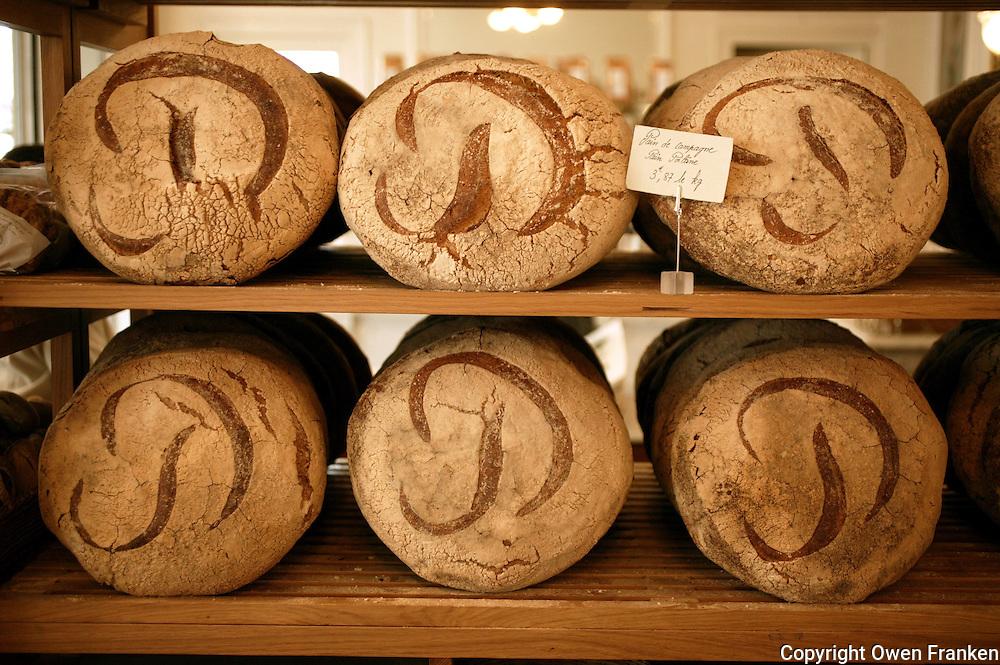 """the famous """"P"""" marked Pain de Campagne....The Bakery Lionel Poilane on Bd. de Grenelle, Paris................. photo by Owen Franken......"""