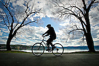 JEROME A. POLLOS/Press..A bicyclist pedals along the lake Thursday on the Centennial Trail in Coeur d'Alene. The League of American Bicyclists has designated Coeur d'Alene a Bicycle Friendly Community at the Bronze level for its trails and ordinances that promote bike-friendly planning and development.