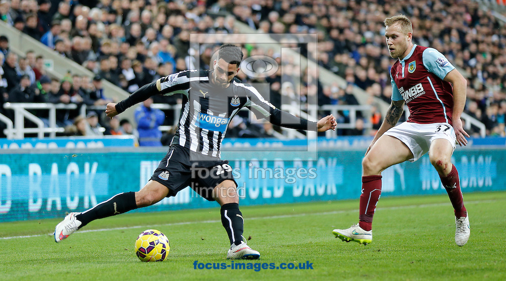 Emmanuel Riviere (l) of Newcastle United and Scott Arfield of Burnley during the Barclays Premier League match at St. James's Park, Newcastle<br /> Picture by Simon Moore/Focus Images Ltd 07807 671782<br /> 01/01/2015