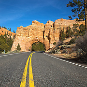 Roadway rock arch in Red Canyon, located along southern Utah's Scenic Byway 12 just nine miles from Bryce Canyon.