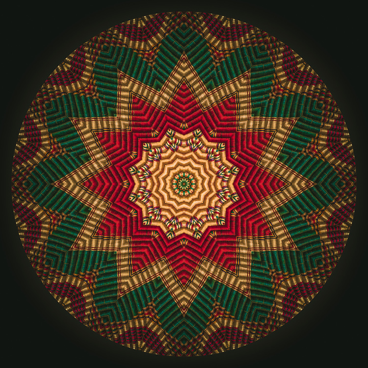 Wicker textured Mandala with a 12 point star radiating pan-African red, gold and green colors.