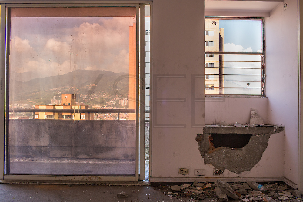 "2015/11/20 - Medellín, Colombia: Hole in a wall of one of the many rooms in Pablo Escobar penthhouse in Monaco building, Medellín. After Colombia's most famous drug lord death, people entered his former home and started to make holes on the walls and ceilings looking for hidden cash. Pablo Escobar once was named by Forbes magazine as the 7th richer man in the world. Tours focusing on the life and death of Pablo Escobar are becoming quite popular among international tourists that visit Medellín. In recent times more than 10 tour operators have started to give the tour, helped by the interest generated by Netflix ""Narcos"" series. (Eduardo Leal)"
