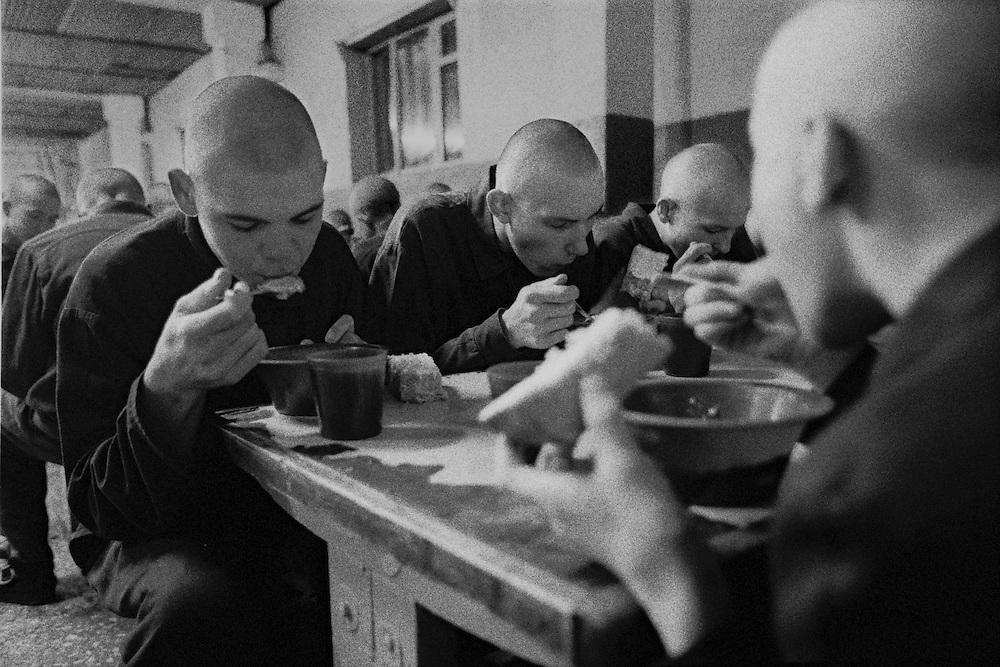 The prisoners children eat their bread and porridge during supper at the colony for prisoner's children in Siberian town Leninsk-Kuznetsky, Russia, 26 January 2000.