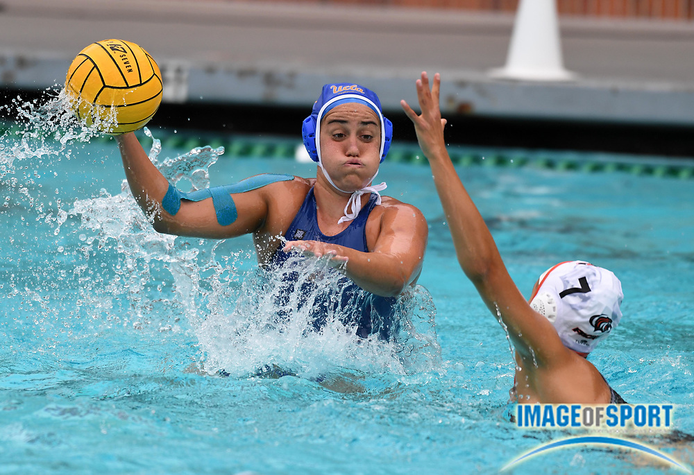 UCLA Bruins attacker Devin Grab (8) is defended by Pacific Tigers attacker Vikoria Tamas (7) during an NCAA college women's water polo quarterfinal game in Los Angeles, Friday, May 11, 2018. UCLA defeated Pacific, 8-4.