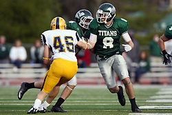12 November 2011:  Joe Musso gets a block on Luke Kowalczyk from Tate Musselman during an NCAA division 3 football game between the Augustana Vikings and the Illinois Wesleyan Titans in Tucci Stadium on Wilder Field, Bloomington IL