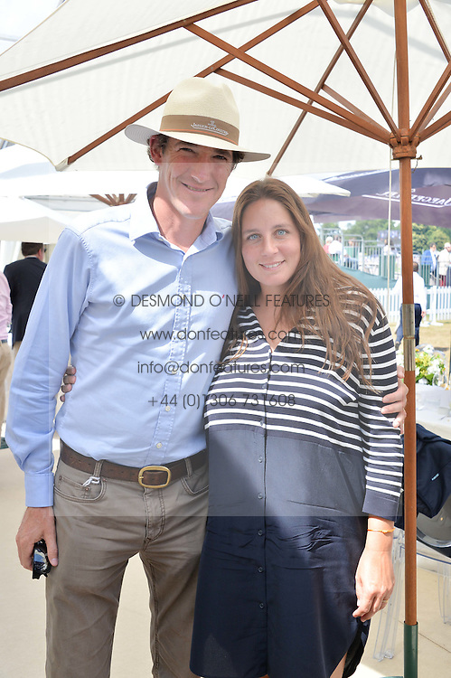 LUKE & CATA TOMLINSON at the Jaeger-LeCoultre Gold Cup Polo Final held at Cowdray Park Polo Club, Midhurst, West Sussex on 19th July 2015