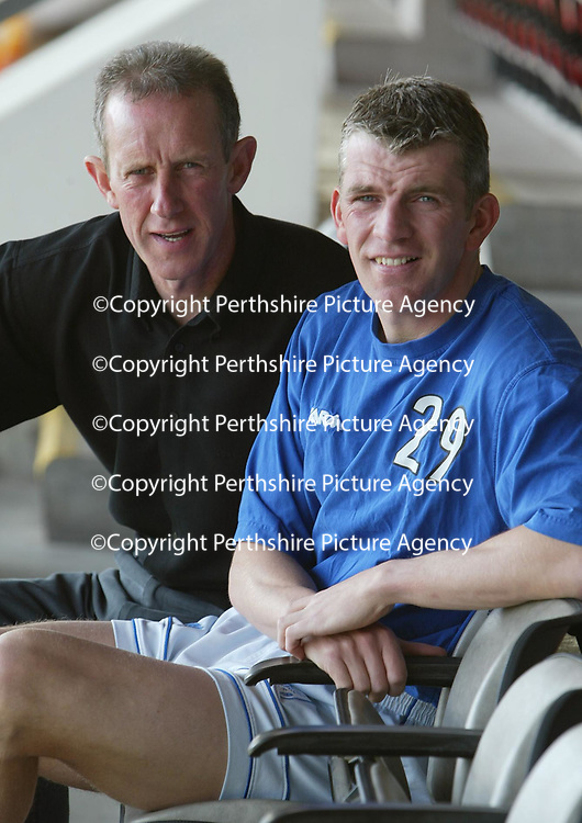 St Johnstone's Jim Weir, happy after signing a 12 month contract today despite his recent injury hell... He is pictured with manager Billy Stark.<br />